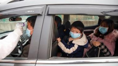 Familias en China toman medidas para evitar la propagación de la enfermedad